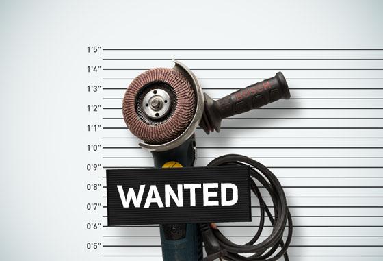 Kværner interaction. Plakat med et en vinkelkutter med teksten «Wanted» stort på en plakat foran kutteren. Viser til amerikanske mugshots.